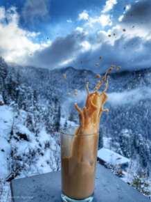 Splashing tea on the backdrop of Icy Himalayas.
